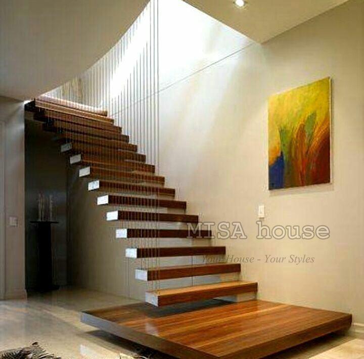 Trang trí cầu thang phòng khách không tay vịn bằng tranh